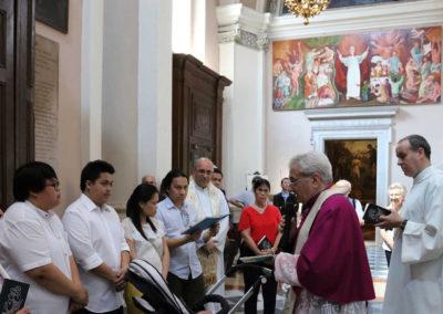 Mons. Mario Piccinelli, Rettore del Santuario, celebra il Battesimo